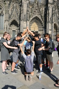 Students are involved in a demonstration to determine the best way to build a cathedral